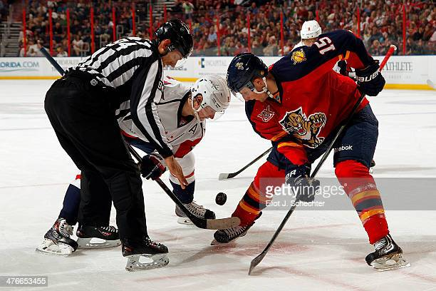 Drew Shore of the Florida Panthers faces of against Nicklas Backstrom of the Washington Capitals at the BBT Center on February 27 2014 in Sunrise...