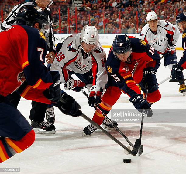 Drew Shore of the Florida Panthers faces off against Nicklas Backstrom of the Washington Capitals at the BBT Center on February 27 2014 in Sunrise...