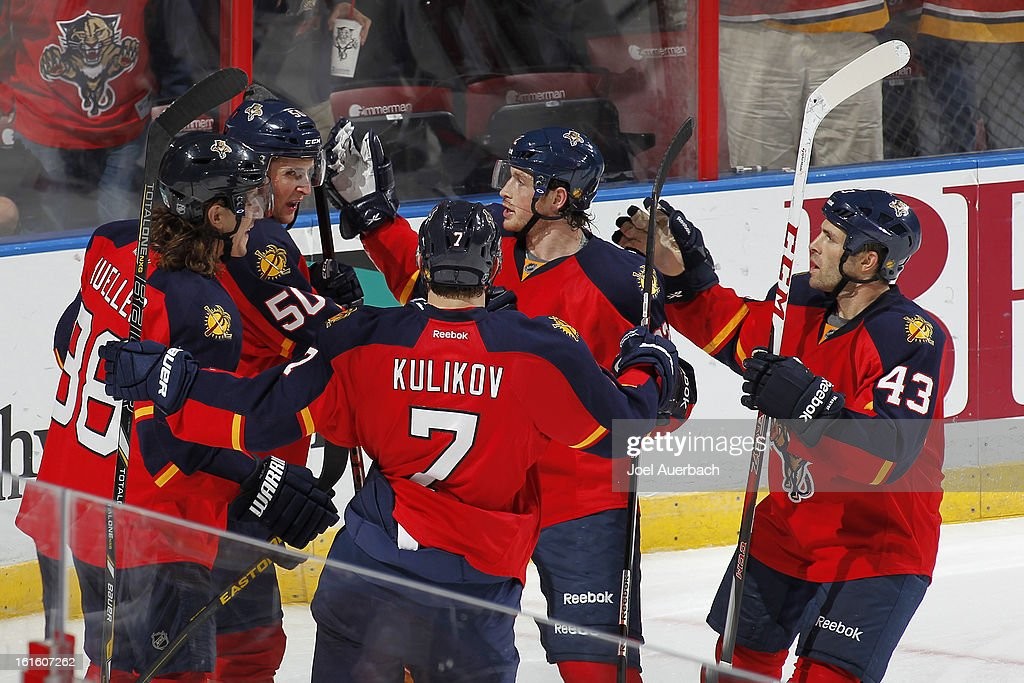 Drew Shore #50 of the Florida Panthers is congratulated by teammates after scoring his first goal in the NHL during the third period against the Washington Capitals at the BB&T Center on February 12, 2013 in Sunrise, Florida. The Capitals defeated the Panthers 6-5 in overtime.
