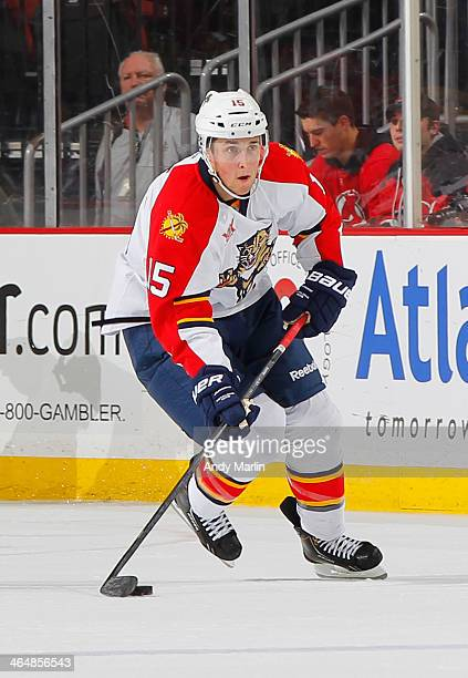Drew Shore of the Florida Panthers plays the puck against the New Jersey Devils during the game at the Prudential Center on January 11 2014 in Newark...