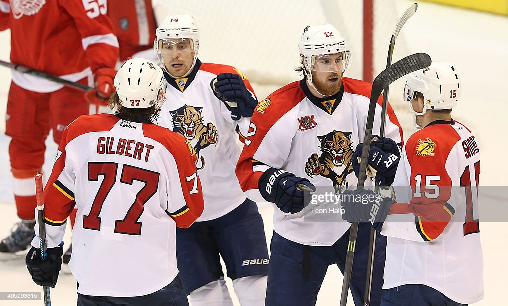 <a gi-track='captionPersonalityLinkClicked' href=/galleries/search?phrase=Drew+Shore&family=editorial&specificpeople=4779287 ng-click='$event.stopPropagation()'>Drew Shore</a> #15 of the Florida Panthers scores a goal in the third period and is congratulated by teammate Jimmy Hayes #12 during the game against the Detroit Red Wings at Joe Louis Arena on January 26, 2014 in Detroit, Michigan. The Panthers defeated the Wings 5-4 in a shootout