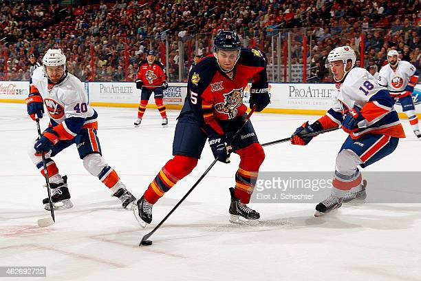 Drew Shore of the Florida Panthers shoots and scores against the New York Islanders at the BBT Center on January 14 2014 in Sunrise Florida