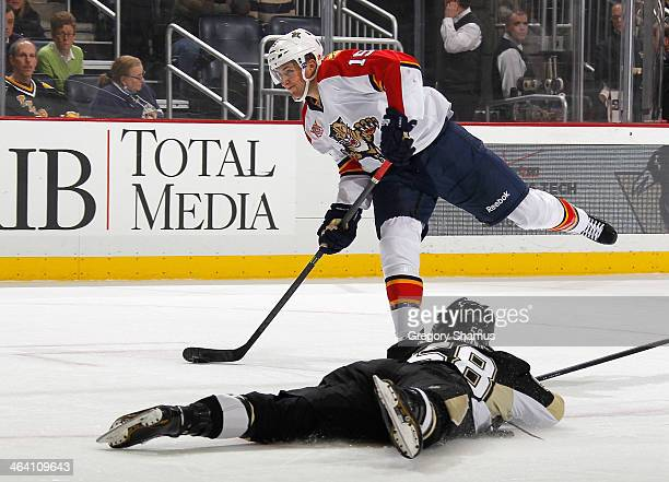 Drew Shore of the Florida Panthers shoots and scores in front of Kris Letang of the Pittsburgh Penguins on January 20 2014 at Consol Energy Center in...