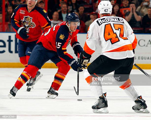 Drew Shore of the Florida Panthers skates with the puck against Andrew McDonald of the Philadelphia Flyers at the BBT Center on April 8 2014 in...