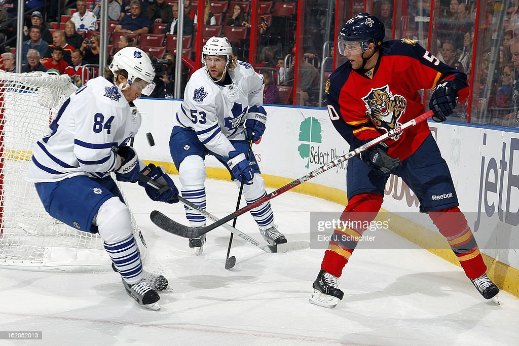 Drew Shore #50 of the Florida Panthers tangles with Mikhail Grabovski #84 of the Toronto Maple Leafs at the BB&T Center on February 18, 2013 in Sunrise, Florida.