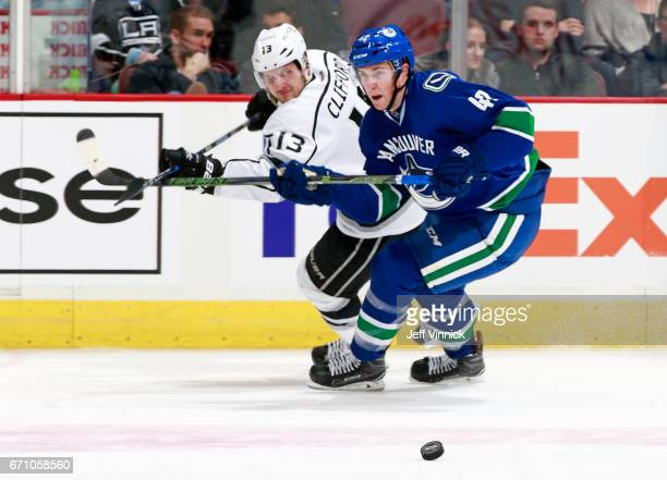 Drew Shore of the Vancouver Canucks and Kyle Clifford of the Los Angeles Kings watch a loose puck during their NHL game at Rogers Arena March 31 2017...
