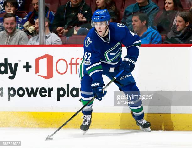 Drew Shore of the Vancouver Canucks skates up ice with the puck during their NHL game against the Anaheim Ducks at Rogers Arena March 28 2017 in...