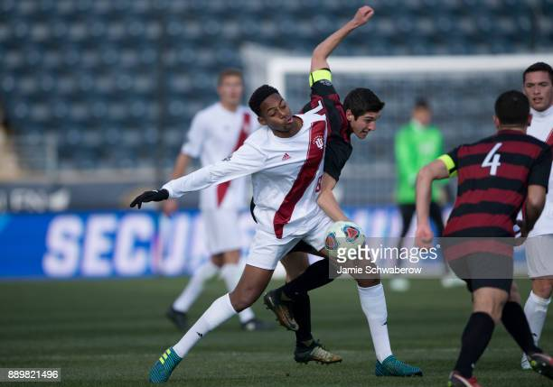Drew Skundrich of Stanford University and Mason Toye of Indiana University battle for the ball during the Division I Men's Soccer Championship held...