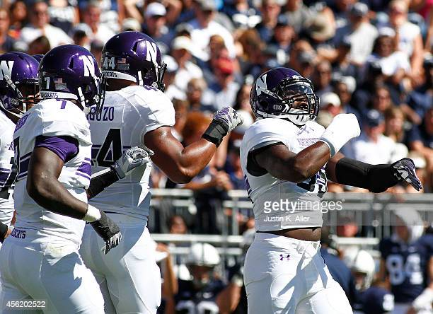 Drew Smith of the Northwestern Wildcats celebrates after sacking the quarterback in the first half against the Penn State Nittany Lions during the...
