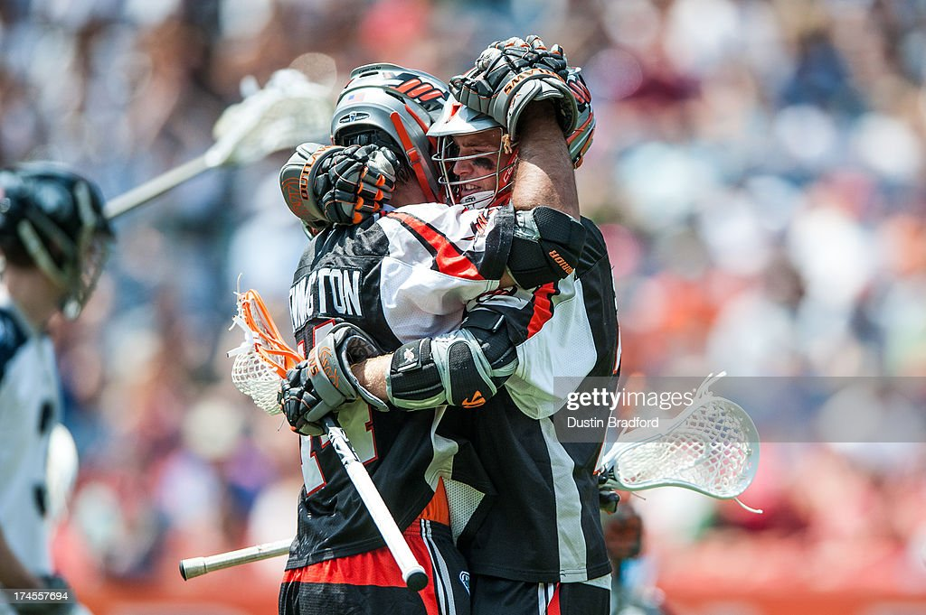 Drew Snider #23 of the Denver Outlaws (right) congratulates Justin Pennington #14 on a second half goal against the Chesapeake Bayhawks during a Major League Lacrosse game at Sports Authority Field at Mile High on July 27, 2013 in Denver, Colorado. The Outlaws beat the Bayhawks 14-12.