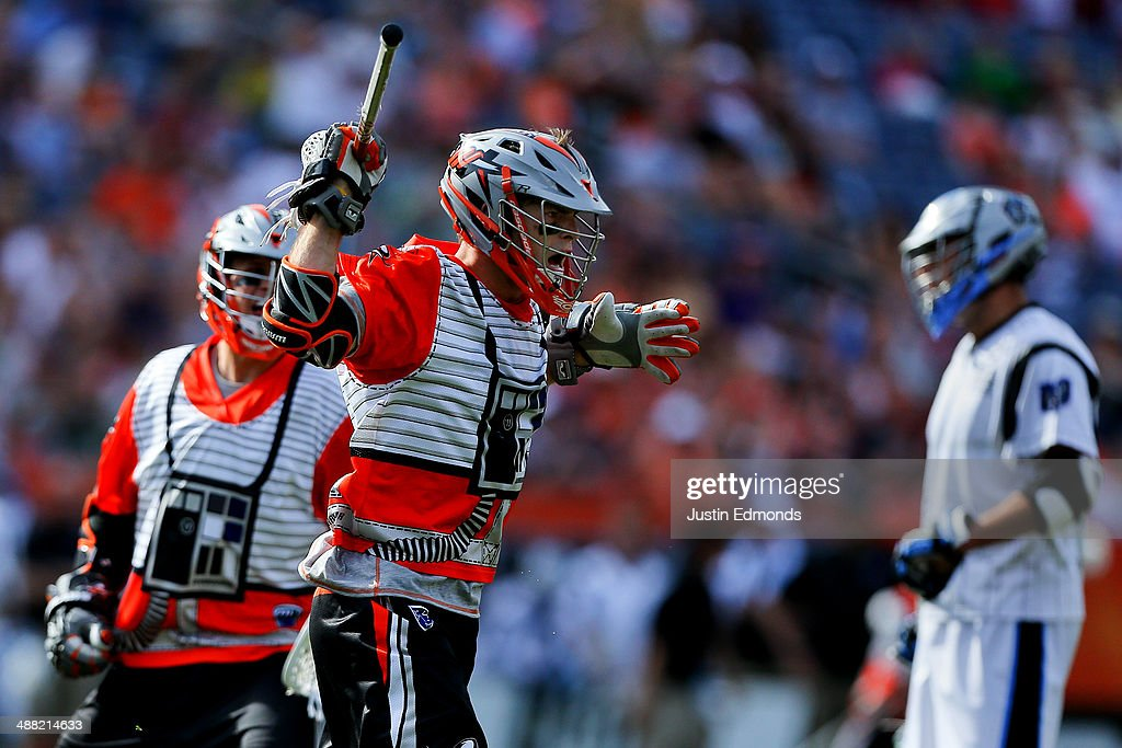 Drew Snider #23 of the Denver Outlaws reacts after scoring the game-tying goal during the fourth quarter against the Ohio Machine at Sports Authority Field at Mile High on May 4, 2014 in Denver, Colorado. The teams wore Star Wars themed jerseys in honor of 'May-The-4th-Be-With-You' day.The Outlaws defeated the Machine 14-12.