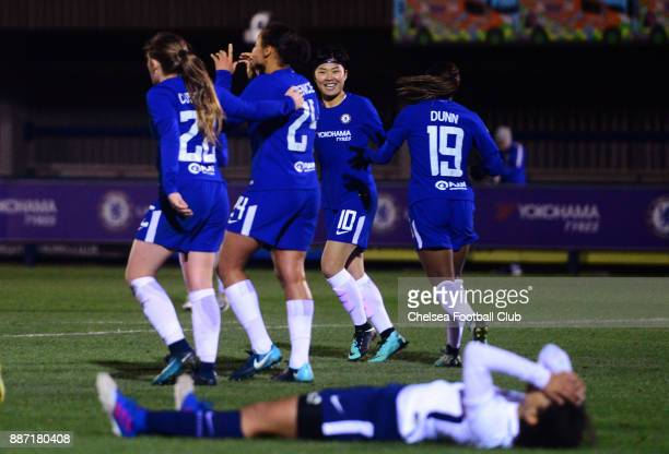 Drew Spence of Chelsea celebrates with her team mates in front of dejected Tottenham player after she scores to make it 41 during a Continental Tyres...