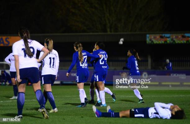 Drew Spence of Chelsea celebrates with her team mates in front of dejected Tottenham players after she scores to make it 41 during a Continental...