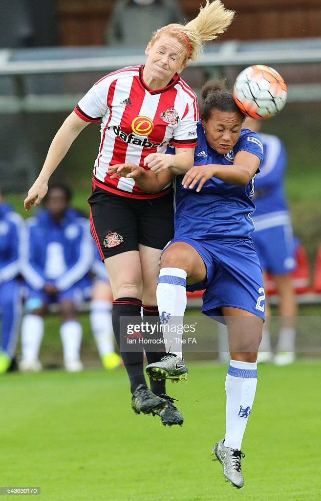 Drew Spence of Chelsea (R) tussles with Rachel Furness of Sunderland during the WSL 1 League match between Sunderland Ladies and Chelsea Ladies FC at the Hetton Center on June 29, 2016 in Hetton, England.
