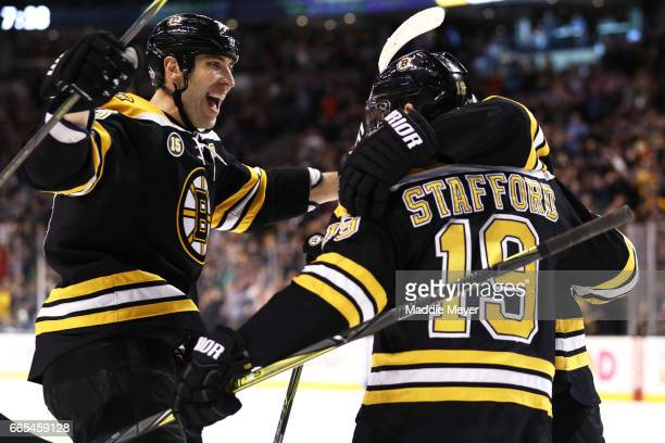 Drew Stafford of the Boston Bruins celebrates with Zdeno Chara after he scored against the Ottawa Senators during the first period at TD Garden on...
