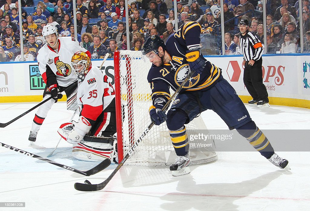 <a gi-track='captionPersonalityLinkClicked' href=/galleries/search?phrase=Drew+Stafford&family=editorial&specificpeople=220617 ng-click='$event.stopPropagation()'>Drew Stafford</a> #21 of the Buffalo Sabres backhands a shot towards <a gi-track='captionPersonalityLinkClicked' href=/galleries/search?phrase=Alex+Auld&family=editorial&specificpeople=217975 ng-click='$event.stopPropagation()'>Alex Auld</a> #35 of the Ottawa Senators at First Niagara Center on November 11, 2011 in Buffalo, New York.