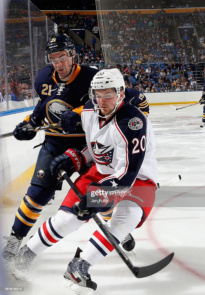 <a gi-track='captionPersonalityLinkClicked' href=/galleries/search?phrase=Drew+Stafford&family=editorial&specificpeople=220617 ng-click='$event.stopPropagation()'>Drew Stafford</a> #21 of the Buffalo Sabres battles along the boards with <a gi-track='captionPersonalityLinkClicked' href=/galleries/search?phrase=Tim+Erixon+-+Hockey+sur+glace&family=editorial&specificpeople=8546945 ng-click='$event.stopPropagation()'>Tim Erixon</a> #20 of the Columbus Blue Jackets during their preseason game at First Niagara Center on September 25, 2013 in Buffalo, New York.