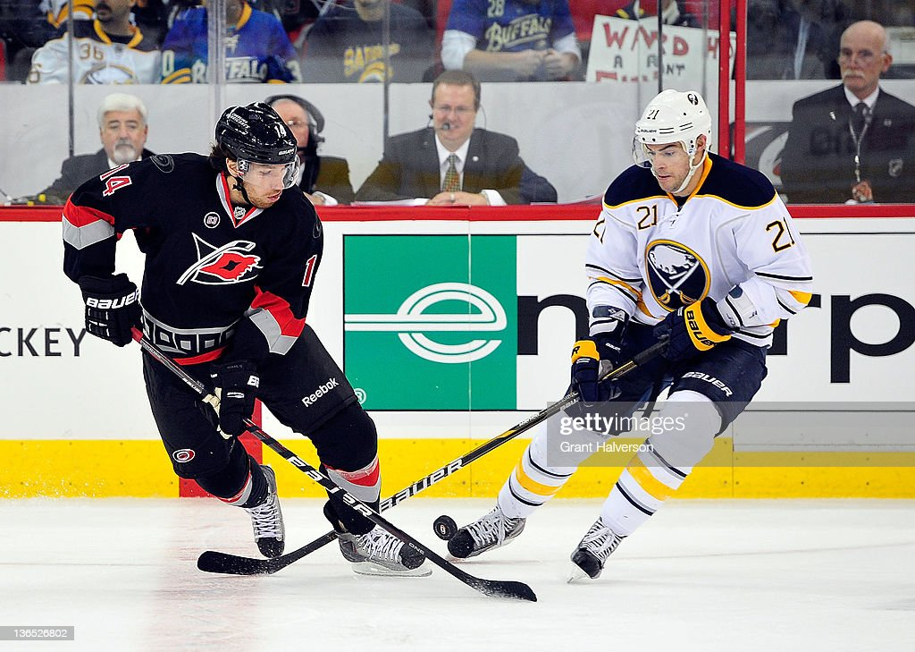 <a gi-track='captionPersonalityLinkClicked' href=/galleries/search?phrase=Drew+Stafford&family=editorial&specificpeople=220617 ng-click='$event.stopPropagation()'>Drew Stafford</a> #21 of the Buffalo Sabres battles for control of the puck with Andreas Nodl #14 of the Carolina Hurricanes during play at the RBC Center on January 6, 2012 in Raleigh, North Carolina.