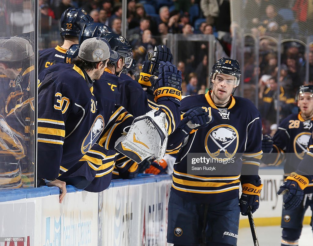<a gi-track='captionPersonalityLinkClicked' href=/galleries/search?phrase=Drew+Stafford&family=editorial&specificpeople=220617 ng-click='$event.stopPropagation()'>Drew Stafford</a> #21 of the Buffalo Sabres celebrates his first-period goal against the Edmonton Oilers with teammates along the bench at First Niagara Center on February 3, 2014 in Buffalo, New York. The Edmonton Oilers defeated the Buffalo Sabres 3-2.