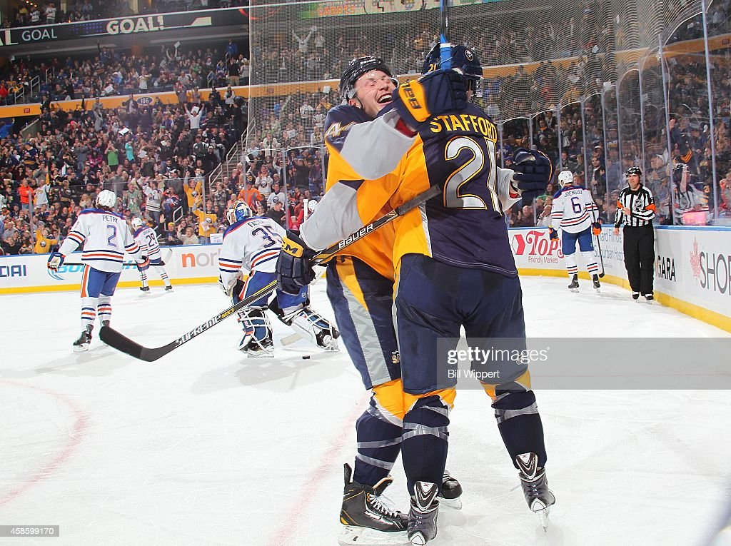 Drew Stafford of the Buffalo Sabres celebrates his third period goal with teammate Nicolas Deslauriers against the Edmonton Oilers on November 7 2014...