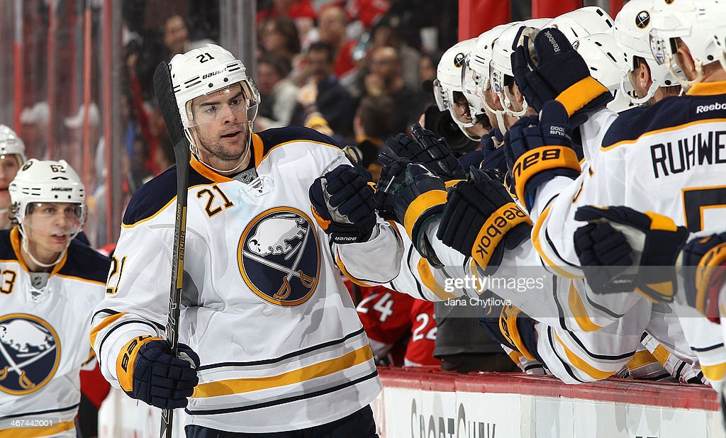 Drew Stafford #21 of the Buffalo Sabres celebrates his third period goal against the Ottawa Senators with team mate Chad Ruhwedel #5 during an NHL game at Canadian Tire Centre on February 6, 2014 in Ottawa, Ontario, Canada.