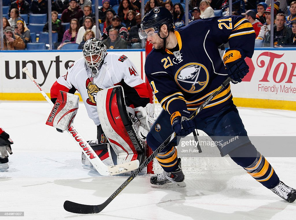Drew Stafford #21 of the Buffalo Sabres controls the puck in front of Robin Lehner #40 of the Ottawa Senators at First Niagara Center on December 10, 2013 in Buffalo, New York.