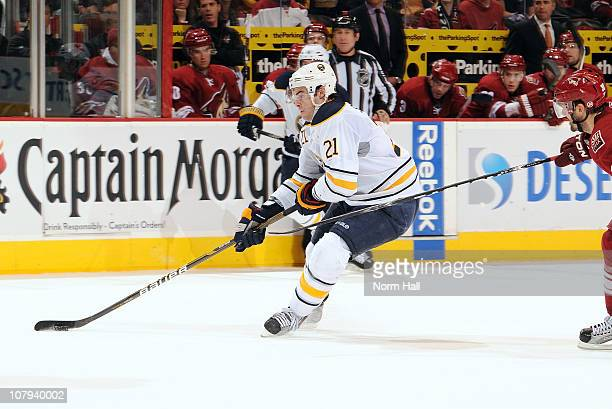 Drew Stafford of the Buffalo Sabres drives the puck to the net for the gamewinning goal against the Phoenix Coyotes on January 8 2011 at Jobingcom...