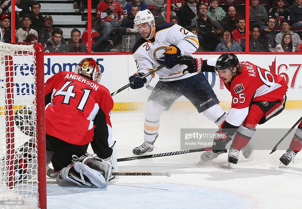 <a gi-track='captionPersonalityLinkClicked' href=/galleries/search?phrase=Drew+Stafford&family=editorial&specificpeople=220617 ng-click='$event.stopPropagation()'>Drew Stafford</a> #21 of the Buffalo Sabres gets in tight to the net for a scoring chance against <a gi-track='captionPersonalityLinkClicked' href=/galleries/search?phrase=Craig+Anderson&family=editorial&specificpeople=211238 ng-click='$event.stopPropagation()'>Craig Anderson</a> #41 and <a gi-track='captionPersonalityLinkClicked' href=/galleries/search?phrase=Erik+Karlsson&family=editorial&specificpeople=5370939 ng-click='$event.stopPropagation()'>Erik Karlsson</a> #65 of the Ottawa Senators at Canadian Tire Centre on December 12, 2013 in Ottawa, Ontario, Canada.