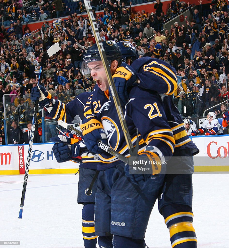 <a gi-track='captionPersonalityLinkClicked' href=/galleries/search?phrase=Drew+Stafford&family=editorial&specificpeople=220617 ng-click='$event.stopPropagation()'>Drew Stafford</a> #21 of the Buffalo Sabres has teammate <a gi-track='captionPersonalityLinkClicked' href=/galleries/search?phrase=Tyler+Ennis+-+Ice+Hockey+Player&family=editorial&specificpeople=4754184 ng-click='$event.stopPropagation()'>Tyler Ennis</a> #63 jump on his back as he celebrates after scoring his third goal of the game against the New York Islanders at HSBC Arena on February 13, 2011 in Buffalo, New York.