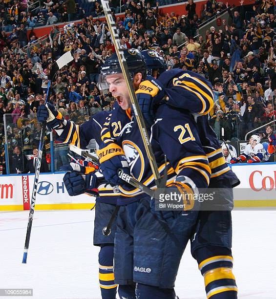 Drew Stafford of the Buffalo Sabres has teammate Tyler Ennis jump on his back as he celebrates after scoring his third goal of the game against the...