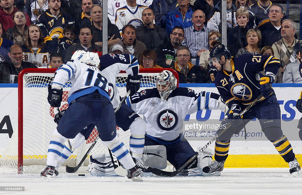 <a gi-track='captionPersonalityLinkClicked' href=/galleries/search?phrase=Drew+Stafford&family=editorial&specificpeople=220617 ng-click='$event.stopPropagation()'>Drew Stafford</a> #21 of the Buffalo Sabres is stopped by Ondrej Pavelec #31 of the Winnipeg Jets as the puck is cleared away by Bryan Little #18 of the Winnipeg Jets during their NHL game at First Niagara Center November 8, 2011 in Buffalo, New York.