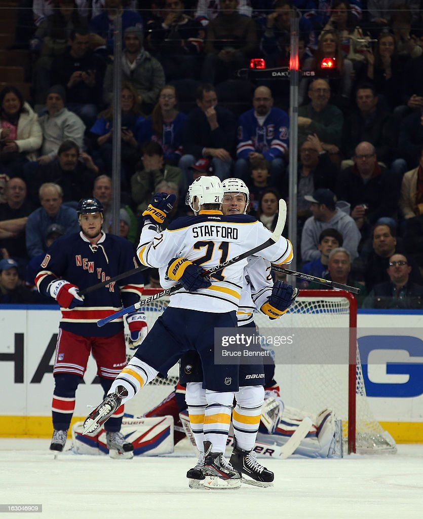 Drew Stafford #21 of the Buffalo Sabres scores at 8:04 of the second period against the New York Rangers and is joined by Mikhail Grigorenko #25 at Madison Square Garden on March 3, 2013 in New York City.