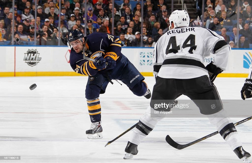 Drew Stafford #21 of the Buffalo Sabres shoots the puck into the zone past Robyn Regehr #44 of the Los Angeles Kings on November 12, 2013 at the First Niagara Center in Buffalo, New York.