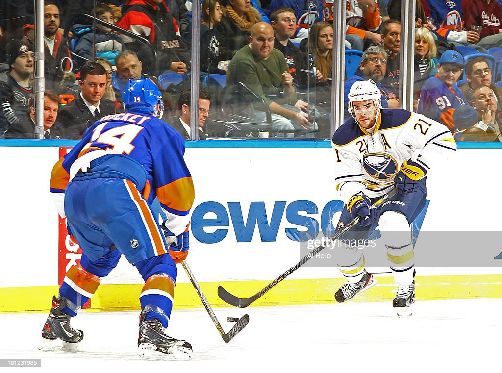Drew Stafford #21 of the Buffalo Sabres skates with the puck against the New York Islanders during their game at Nassau Veterans Memorial Coliseum on February 9, 2013 in Uniondale, New York.