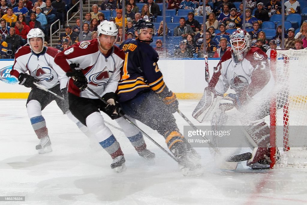 <a gi-track='captionPersonalityLinkClicked' href=/galleries/search?phrase=Drew+Stafford&family=editorial&specificpeople=220617 ng-click='$event.stopPropagation()'>Drew Stafford</a> #21 of the Buffalo Sabres stops in the goal crease between <a gi-track='captionPersonalityLinkClicked' href=/galleries/search?phrase=Jan+Hejda&family=editorial&specificpeople=624333 ng-click='$event.stopPropagation()'>Jan Hejda</a> #8 and <a gi-track='captionPersonalityLinkClicked' href=/galleries/search?phrase=Jean-Sebastien+Giguere&family=editorial&specificpeople=202814 ng-click='$event.stopPropagation()'>Jean-Sebastien Giguere</a> #35 of the Colorado Avalanche on October 19, 2013 at the First Niagara Center in Buffalo, New York. Colorado won, 4-2.