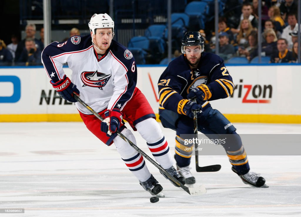 <a gi-track='captionPersonalityLinkClicked' href=/galleries/search?phrase=Drew+Stafford&family=editorial&specificpeople=220617 ng-click='$event.stopPropagation()'>Drew Stafford</a> #21 of the Buffalo Sabres trails <a gi-track='captionPersonalityLinkClicked' href=/galleries/search?phrase=Nikita+Nikitin&family=editorial&specificpeople=722107 ng-click='$event.stopPropagation()'>Nikita Nikitin</a> #6 of the Columbus Blue Jackets with the puck at First Niagara Center on October 10, 2013 in Buffalo, New York. Columbus defeated Buffalo 4-1.