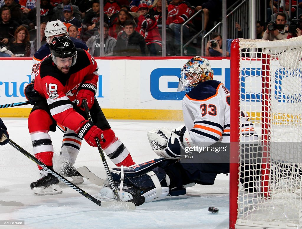 Drew Stafford #18 of the New Jersey Devils gets the puck past Cam Talbot #33 of the Edmonton Oilers in the second period on November 9, 2017 at Prudential Center in Newark, New Jersey.