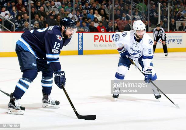 Drew Stafford of the Winnipeg Jets and Nikita Kucherov of the Tampa Bay Lightning get set for a first period faceoff at the MTS Centre on February 11...
