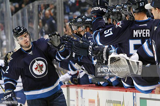 Drew Stafford of the Winnipeg Jets celebrates his first period goal against the Toronto Maple Leafs with teammates at the bench at the MTS Centre on...