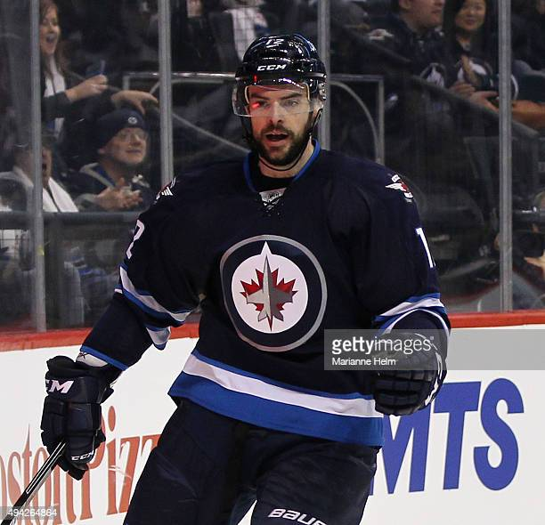 Drew Stafford of the Winnipeg Jets celebrates his goal against Darcy Kuemper of the Minnesota Wild in second period action in an NHL game at the MTS...