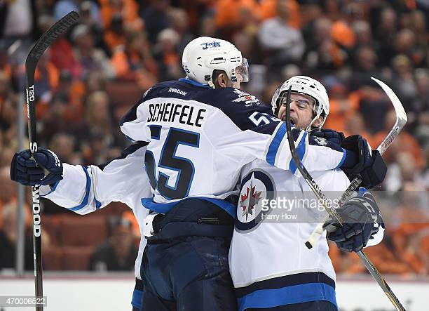 Drew Stafford of the Winnipeg Jets celebrates his goal with Mark Scheifele to take a 21 lead over the Anaheim Ducks during the second period in Game...