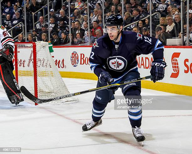 Drew Stafford of the Winnipeg Jets follows the play during first period action against the Chicago Blackhawks at the MTS Centre on October 29 2015 in...