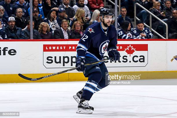 Drew Stafford of the Winnipeg Jets follows the play up the ice during first period action against the San Jose Sharks at the MTS Centre on January 12...