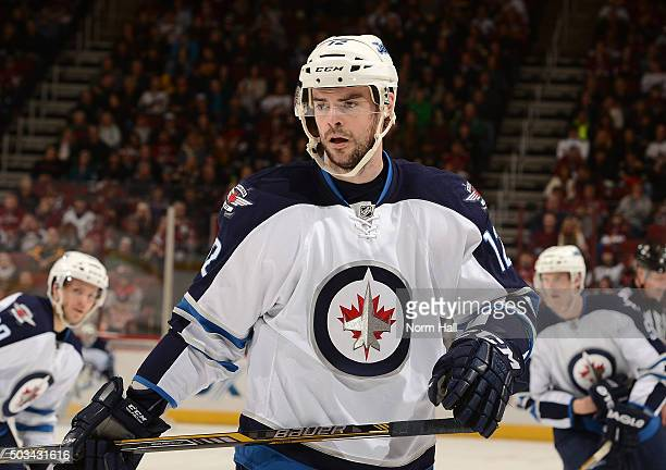 Drew Stafford of the Winnipeg Jets gets ready during a faceoff against the Arizona Coyotes at Gila River Arena on December 31 2015 in Glendale Arizona