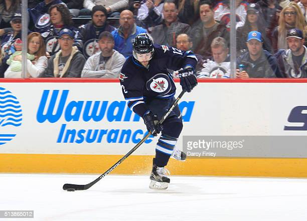 Drew Stafford of the Winnipeg Jets gets set to take a shot on goal during first period action against the Florida Panthers at the MTS Centre on March...
