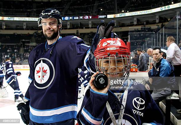 Drew Stafford of the Winnipeg Jets has a bit of fun with the Toyota Trainer of the Day during the pregame warm up prior to NHL action against the...