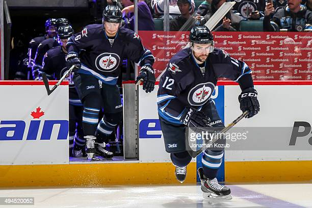 Drew Stafford of the Winnipeg Jets hits the ice prior to puck drop against the St Louis Blues at the MTS Centre on October 18 2015 in Winnipeg...