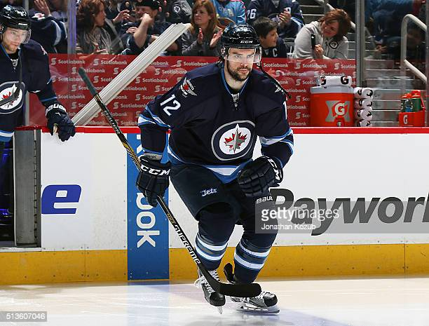 Drew Stafford of the Winnipeg Jets hits the ice prior to puck drop against the New York Islanders at the MTS Centre on March 3 2016 in Winnipeg...