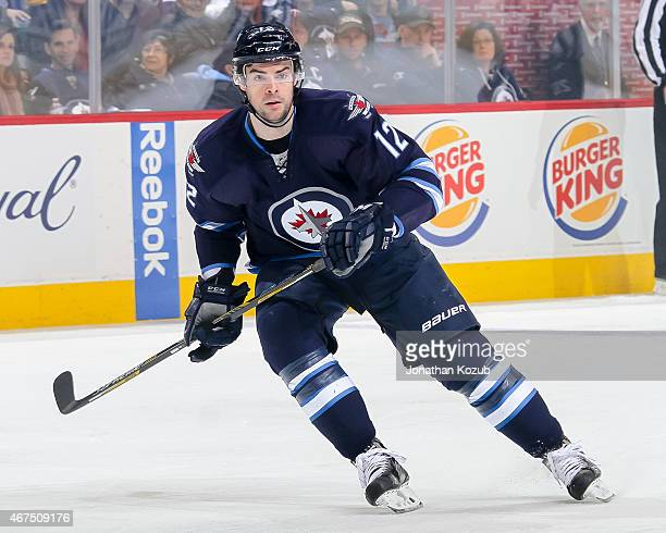 Drew Stafford of the Winnipeg Jets keeps an eye on the play during first period action against the St Louis Blues on March 19 2015 at the MTS Centre...