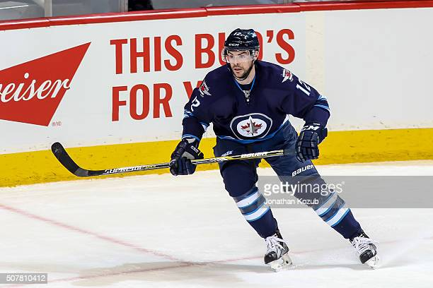 Drew Stafford of the Winnipeg Jets keeps an eye on the play during first period action against the Arizona Coyotes at the MTS Centre on January 26...